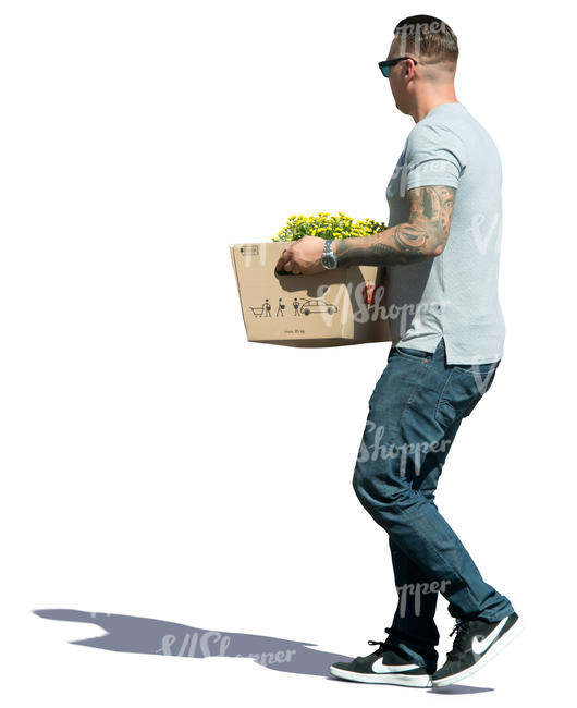 man carrying a box of plants