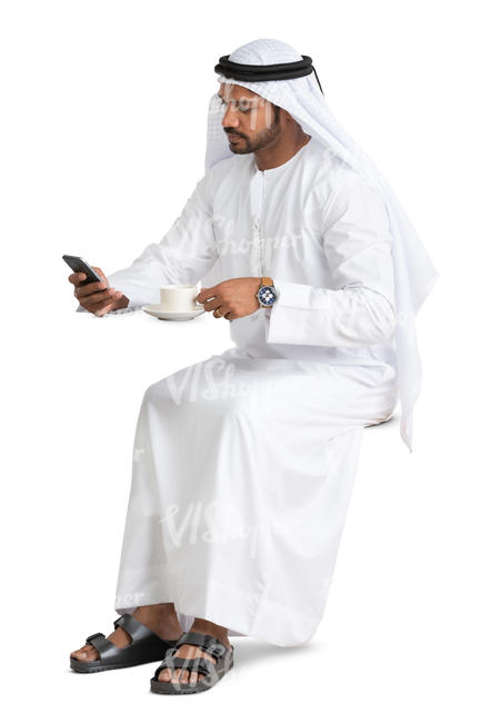 arab man sitting in a cafe