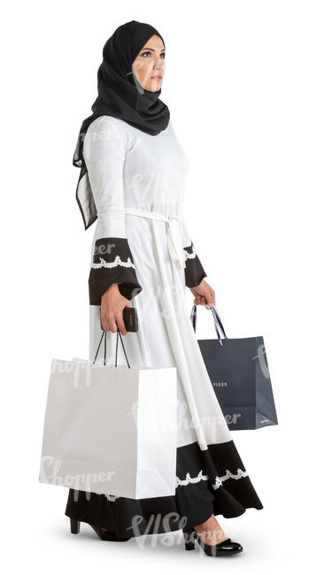 muslim woman in a black and white costume walking