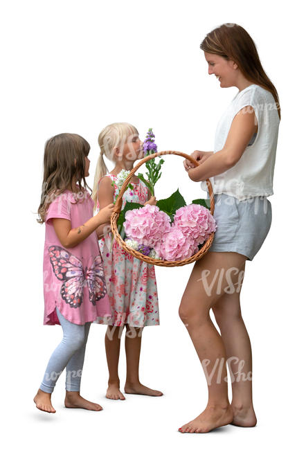 woman with two girls picking flowers