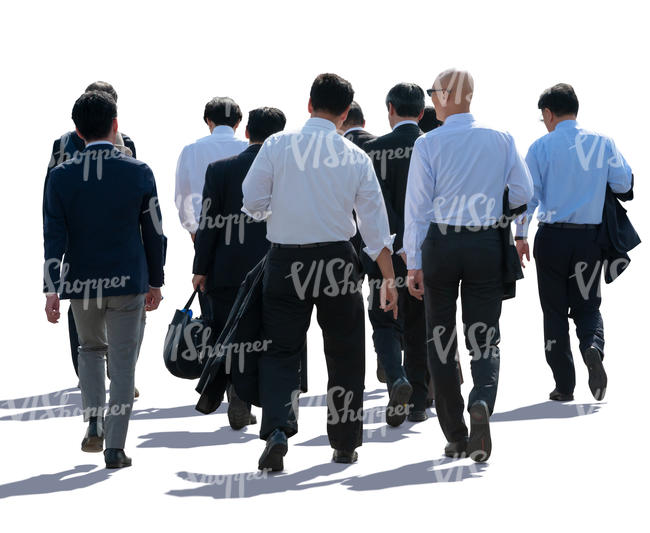 backlit group of businessmen walking
