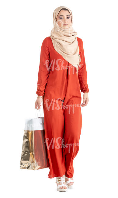 muslim woman in a red abaya shopping