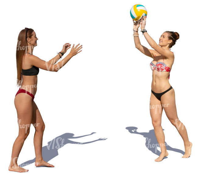 two women in bikinis playing beach volley