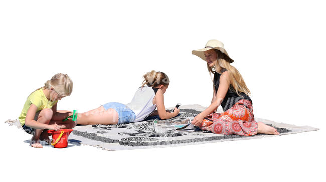 mother with two daughters sitting on a picnic blanket