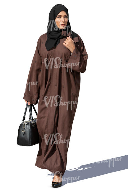 muslim woman in a brown abaya walking