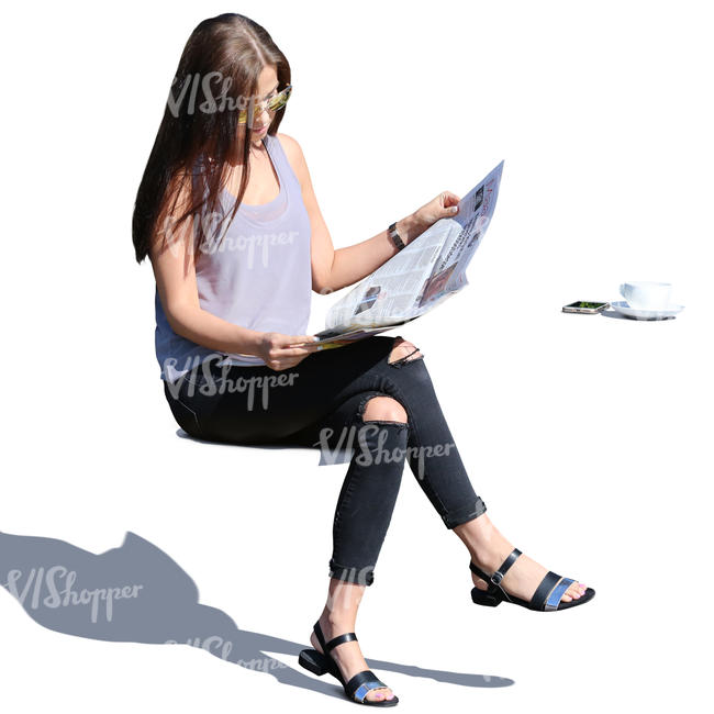 woman sitting in the sun and reading a newspaper
