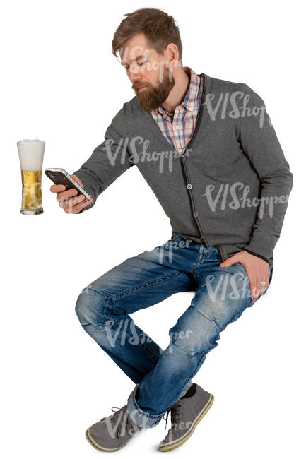man sitting and drinking beer