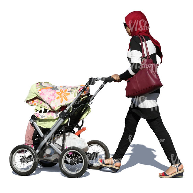 muslim woman with a baby carriage walking