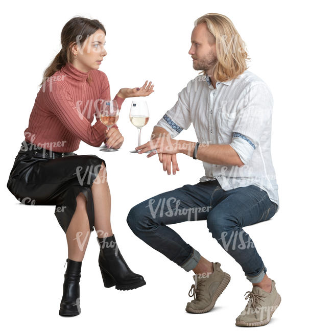 man and woman sitting in a restaurant