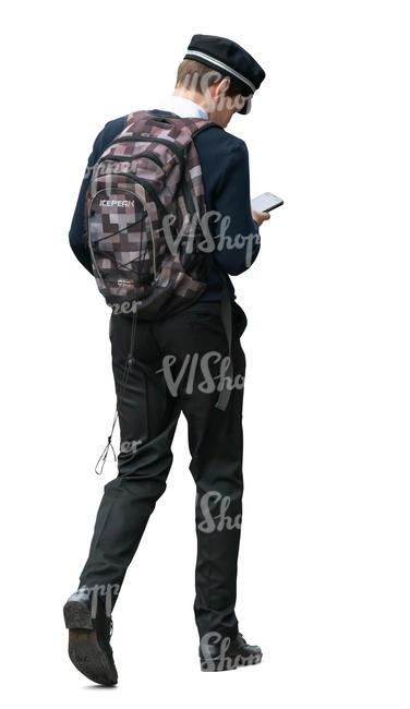 boy in school uniform walking