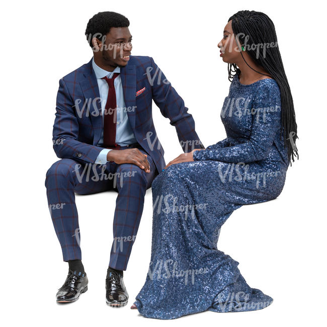 black woman and man sitting on a formal event