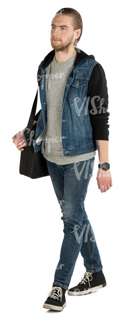 man in a jeans jacket walking