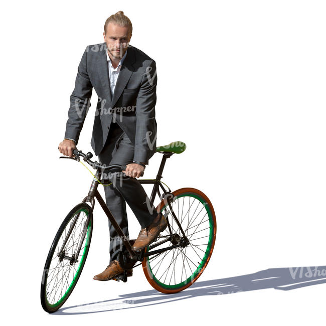 man in a suit riding a bike