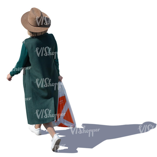 woman with a hat and overcoat walking seen from above