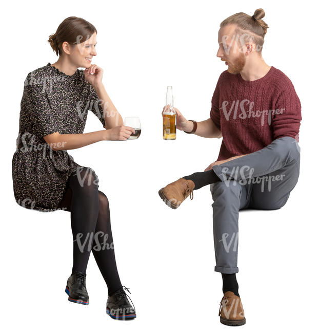 young man and woman sitting and talking in a cafe