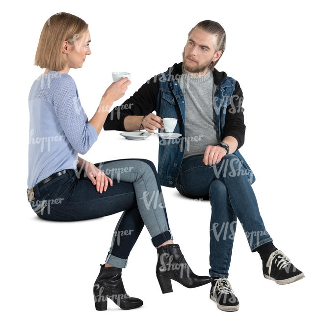 man and woman sitting and drinking coffee