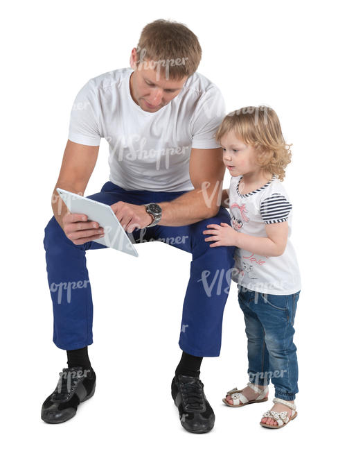 father sitting and looking at tablet with his daughter
