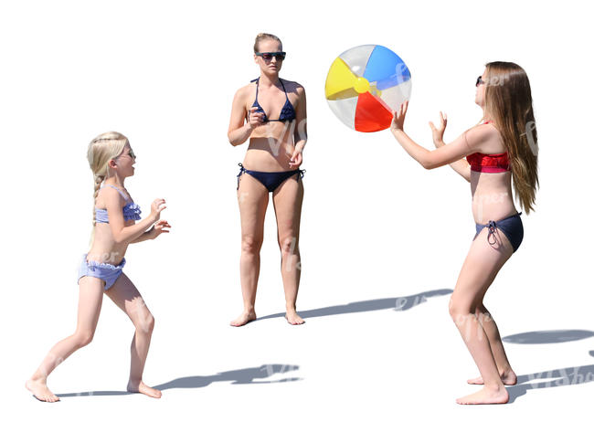 mother with two daughters playing ball at the beach