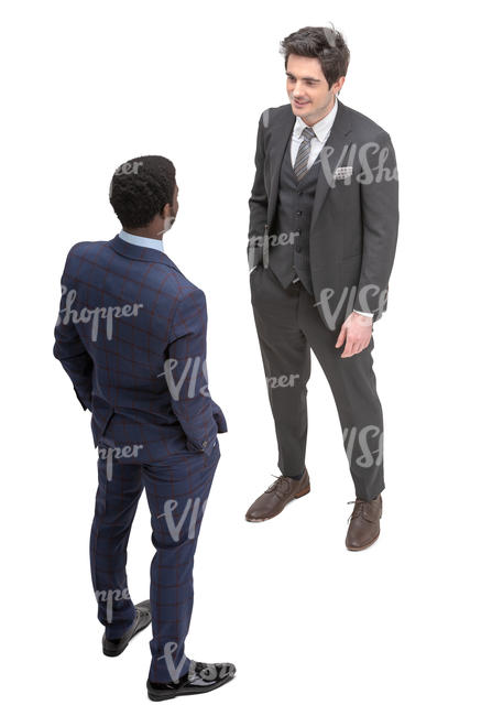 two men in suits talking seen from above