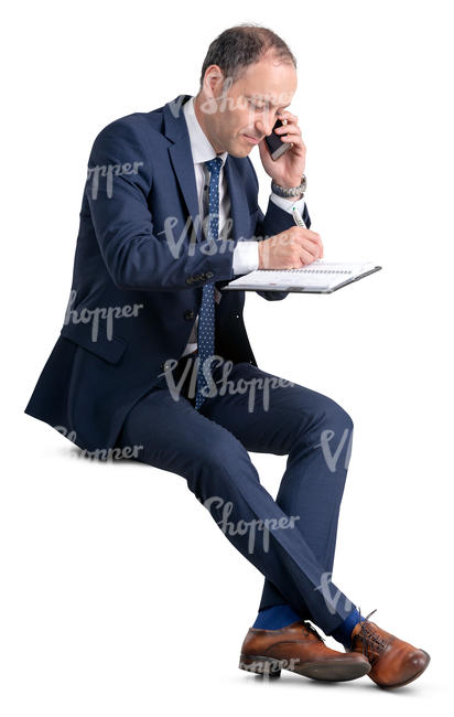 businessman sitting and taking notes
