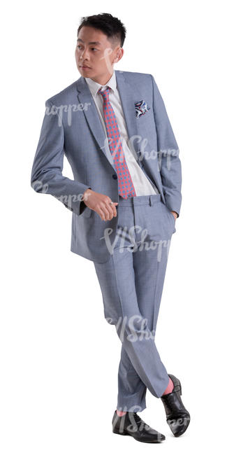 asian man in a grey suit standing
