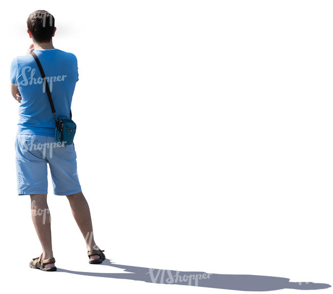 young backlit man standing