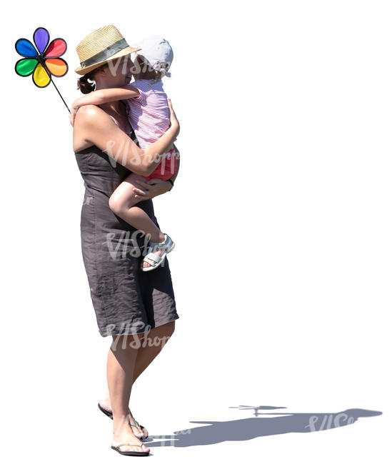 woman walking while carrying her daughter