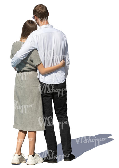 man and woman standing and holding each other