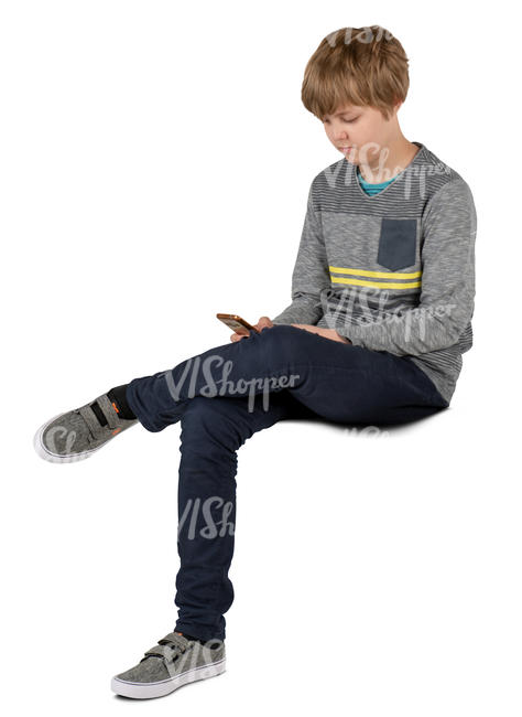 boy sitting and looking at his phone