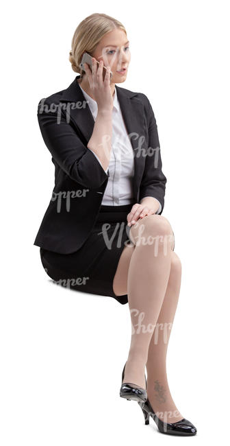 woman in an office sitting and talking on the phone