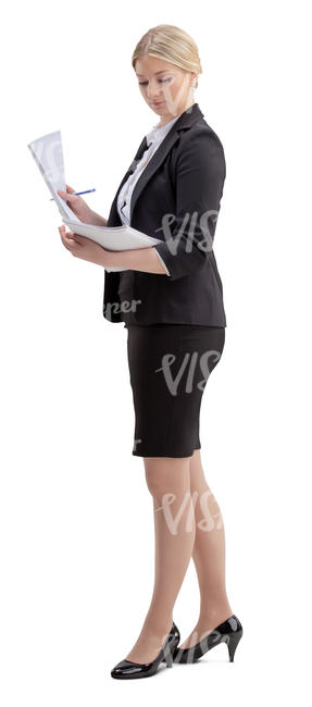 woman in an office standing and looking at papers