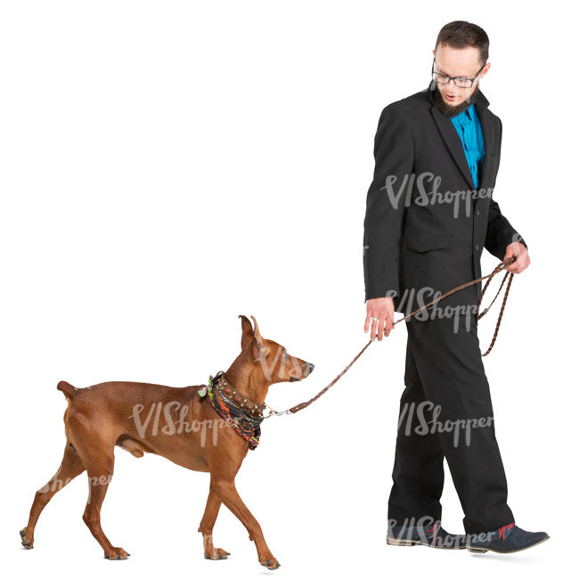 man in a suit walking a dog
