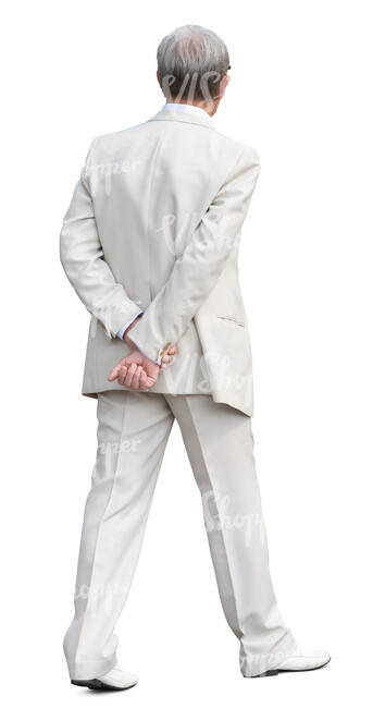 man in a white suit walking