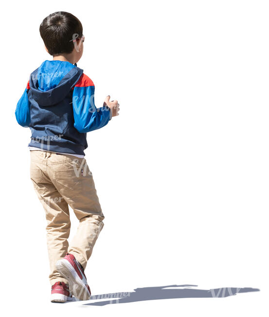 little boy with dark hair walking