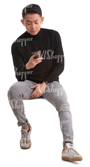 asian man sitting and texting
