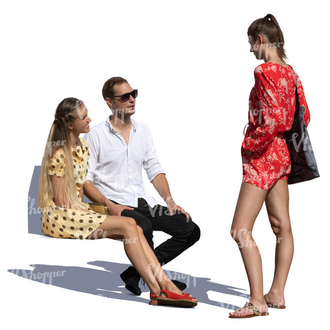 woman talking to a couple sitting on a bench