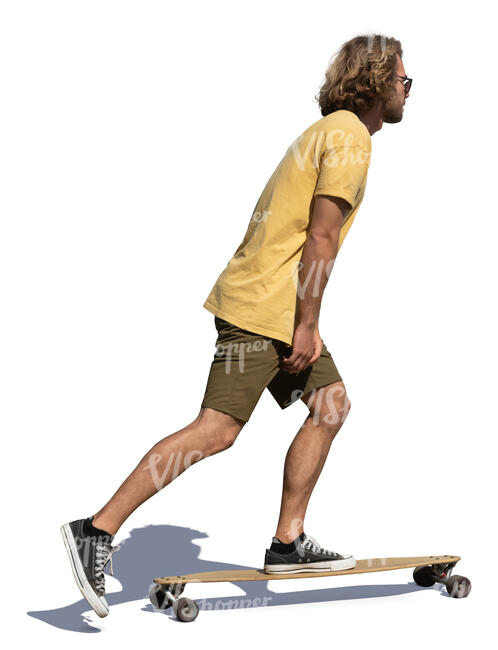 young man riding a longboard