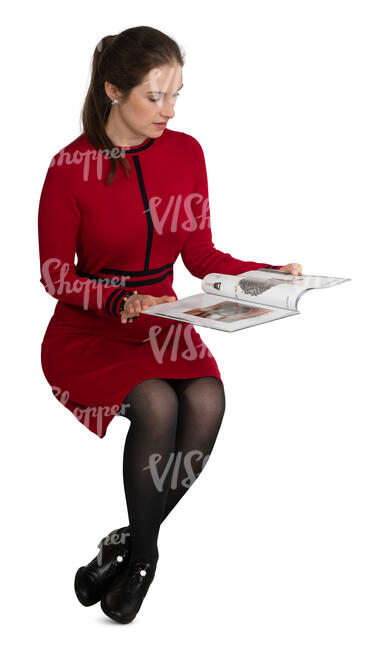 woman in a red dress reading a magazine