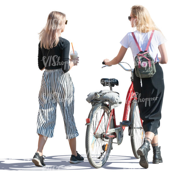 two women with a bike walking and talking