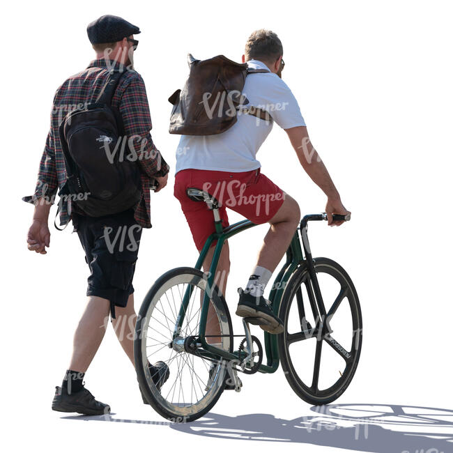 two men talking while one rides a bike