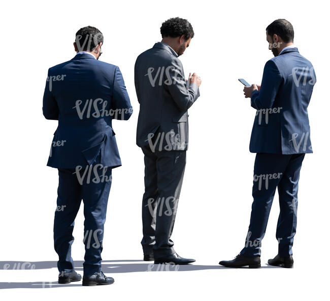 three businessmen standing and checking their phones