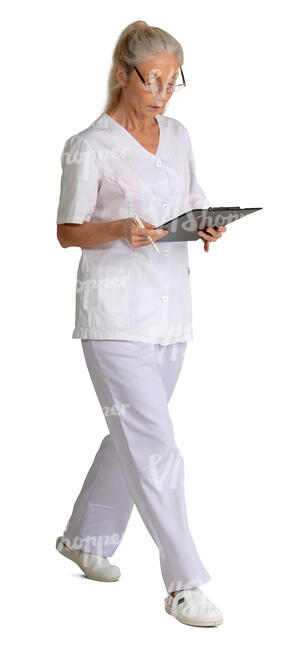 older nurse with some papers walking