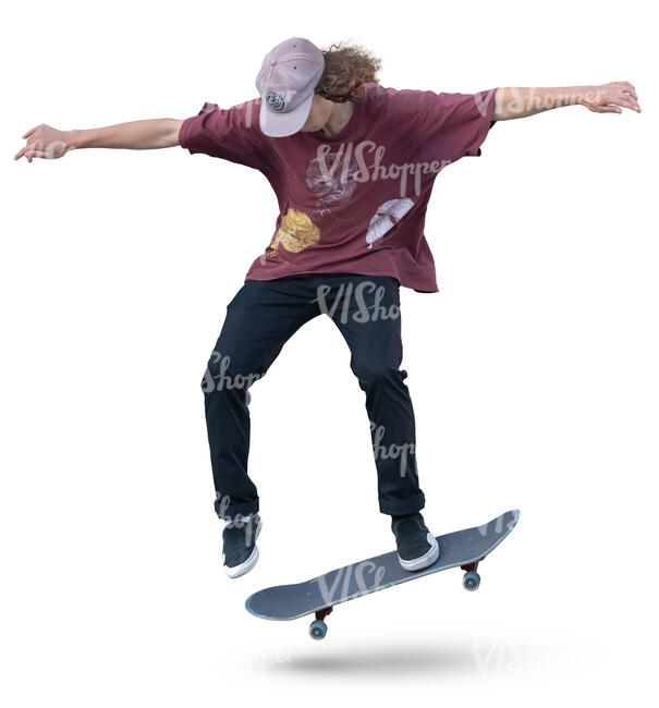 teenage boy doing a stunt on a skateboard