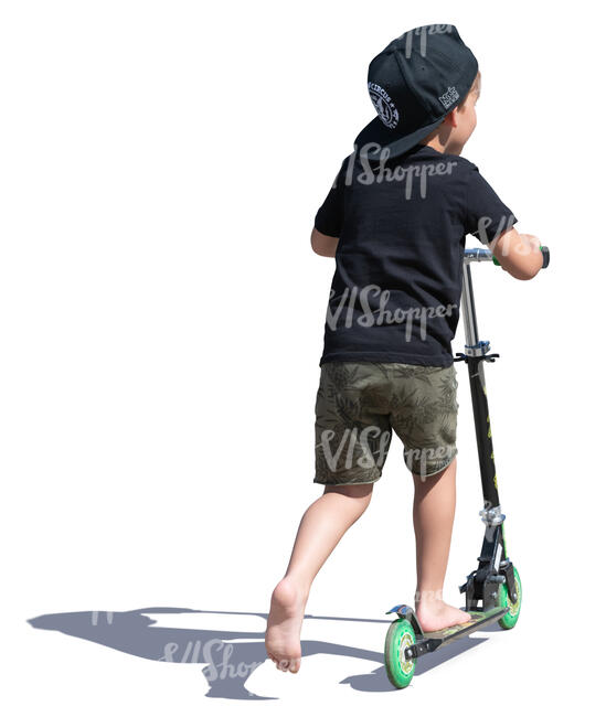 little boy with a hat riding a scooter