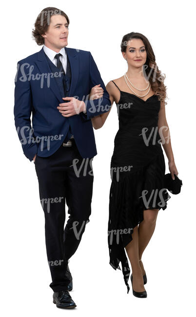 fancy man and woman walking arm in arm