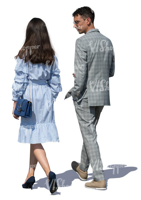 man and woman walking on a summer day