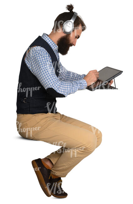 man sittin at a desk and drawing on a graphic tablet