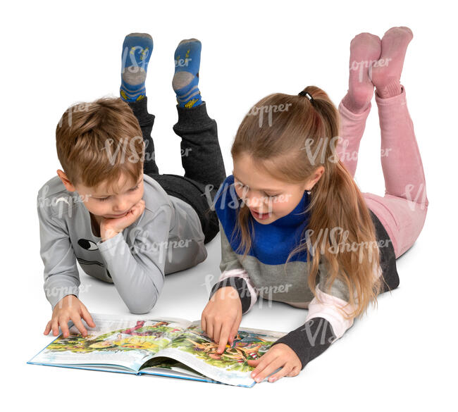 two kids reading a book on the floor