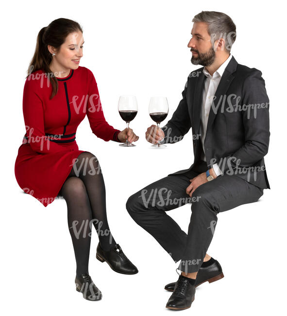 man and woman sitting in a restaurant and drinking wine