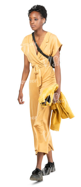 woman in a yellow jumpsuit walking